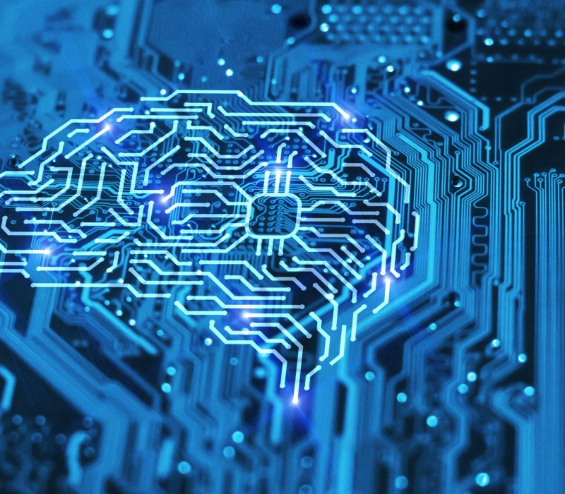 Artificial intelligence brain on blue integrated circuit background. AI, machine learning and neural network concept.
